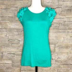 Ted Baker green top with flower appliqués